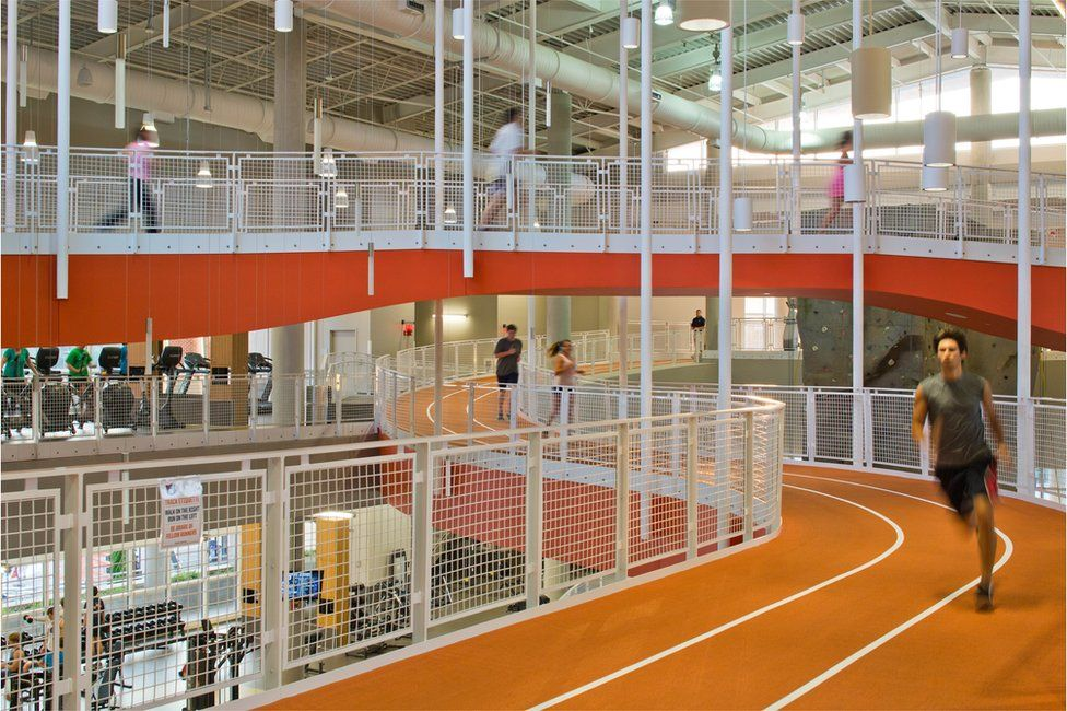 Students running round a race track at a gym at Auburn University in Alabama, USA