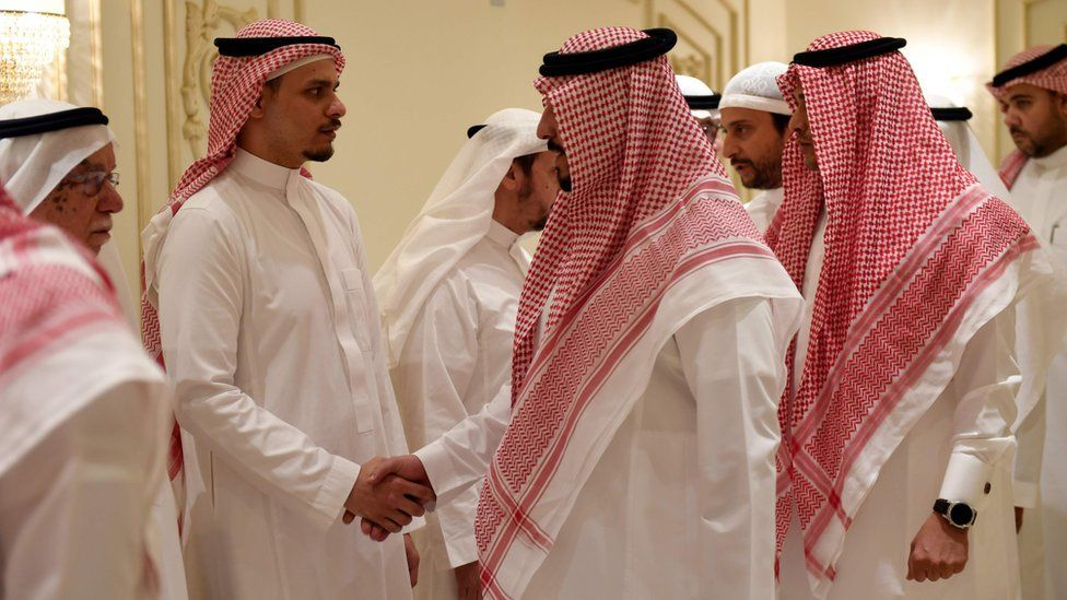 Salah Khashoggi (second left), the son of murdered Saudi journalist Jamal Khashoggi, receives mourners at an events hall in the Saudi coastal city of Jeddah, 16 November 2018