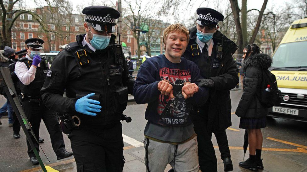 Protester being removed by police