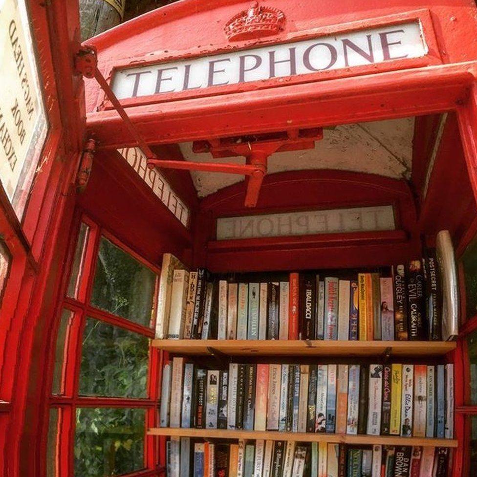 Telephone box full of books