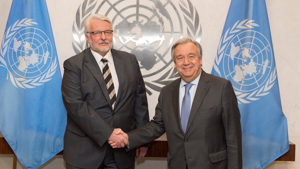 """In this photo provided by the United Nations on Monday Jan. 9, 2017, U.N. Secretary-General Antonio Guterres, right, and Poland""""s Minister for Foreign Affairs Witold Waszczykowski, left, pose for a handshake during their meeting at U.N. headquarters."""