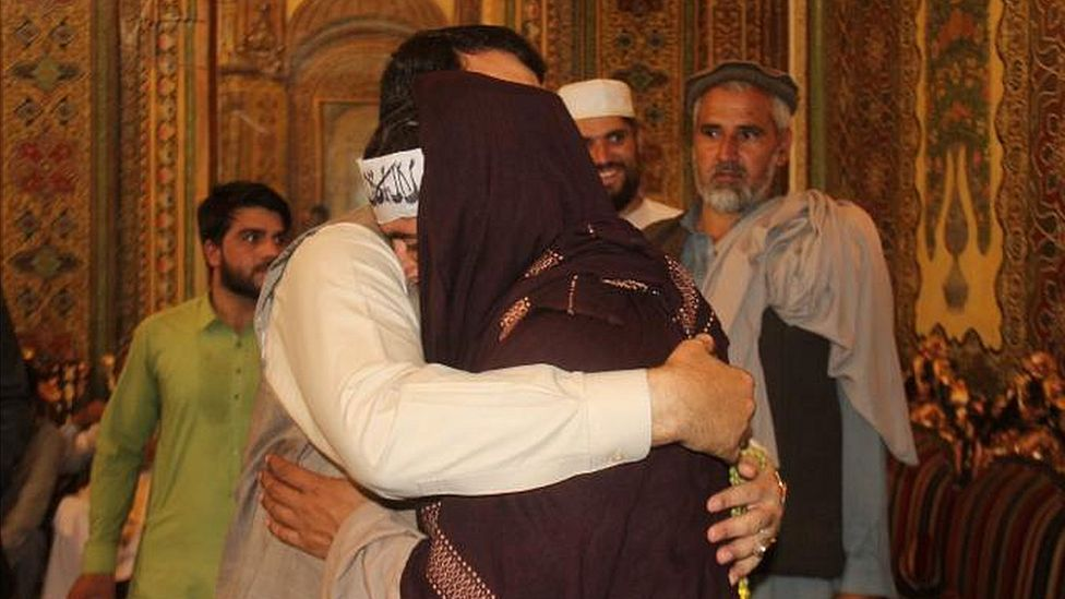 Hayatullah Hayat hugs a member of the Taliban during the June 2018 ceasefire