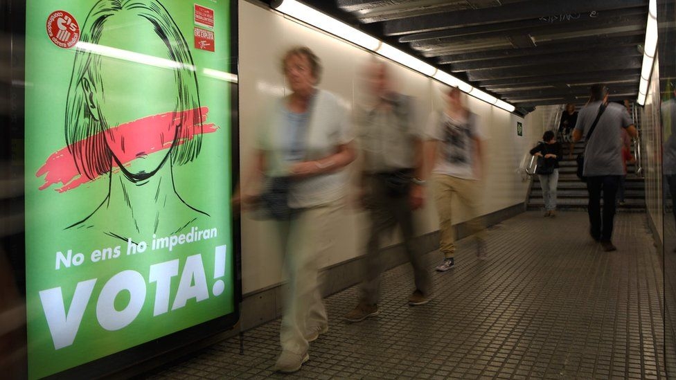 """A poster in the Barcelona metro reads """"They won't stop us voting!"""""""