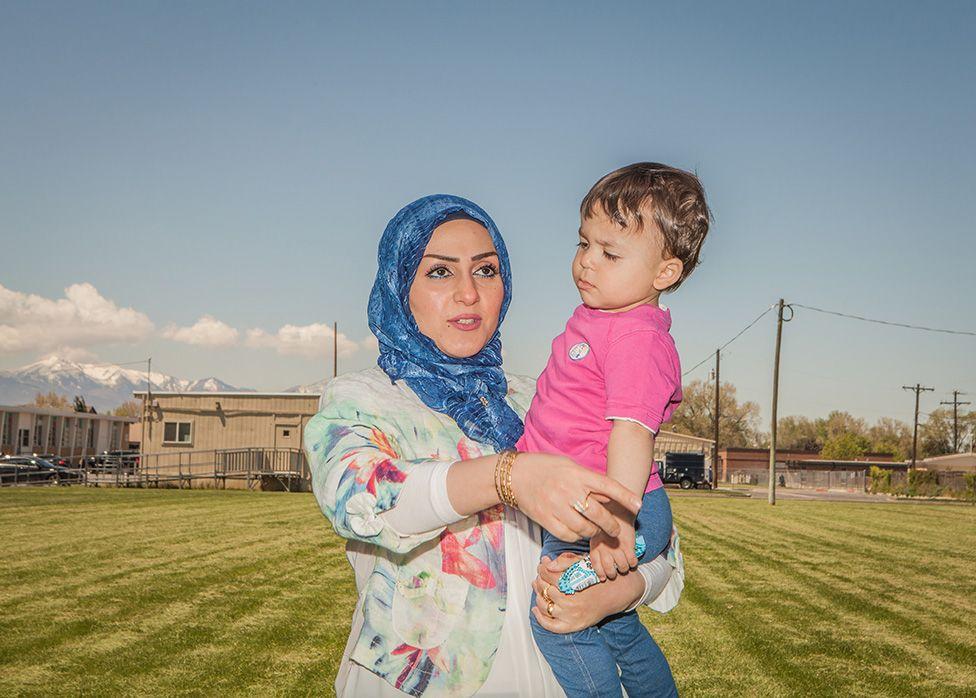 Sura holding a child