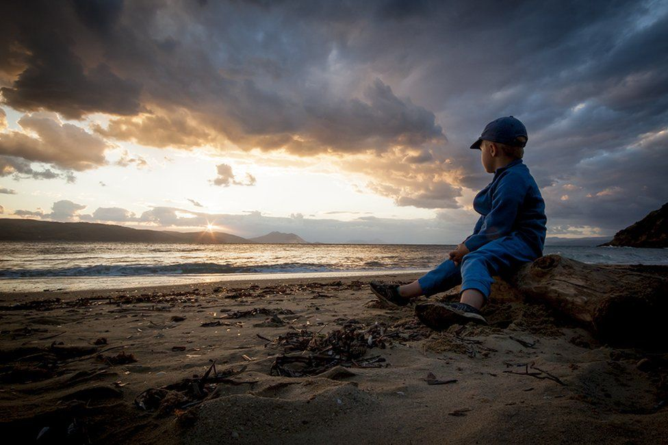 Child looking at a sunset