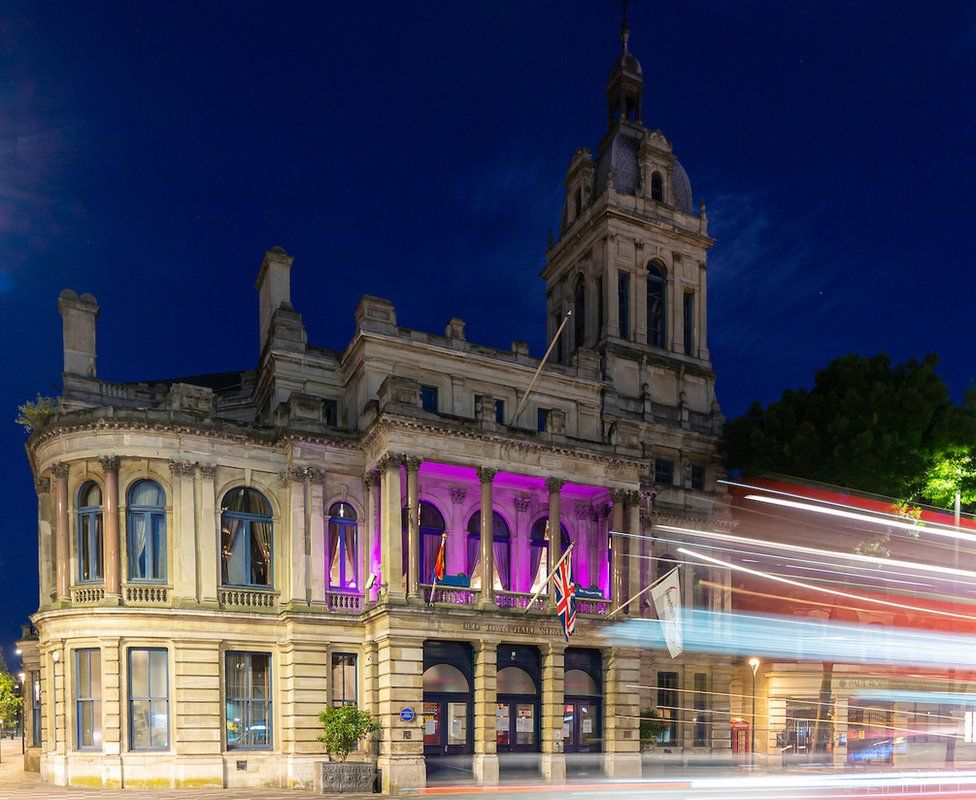 A building in Newham lit up purple