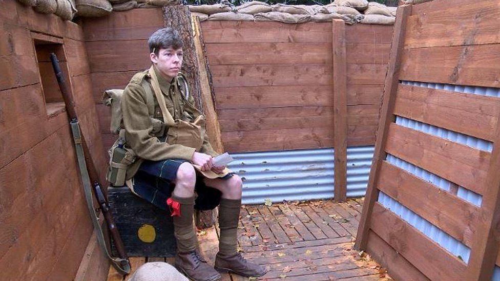 Actor in trench