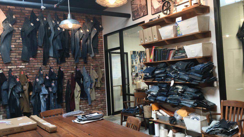 Sample of jean designs on display at Denim North America