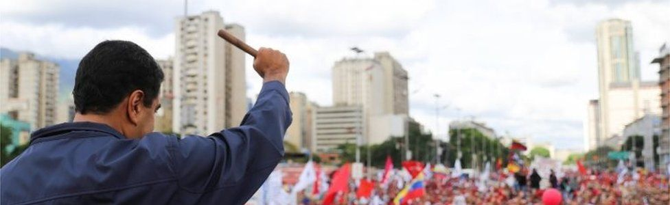 """A handout photo made available by the Miraflores Press Office shows Venezuelan President Nicolas Maduro making a fist during a demonstration of """"Chavistas"""" in Caracas, Venezuela, 01 May 2017"""