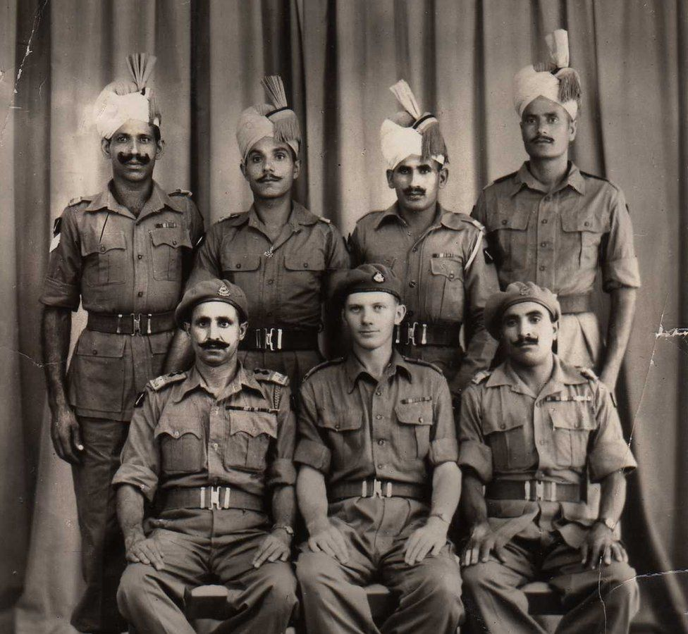 Robin Rowland (seated, centre) with members of the Punjab regiment, pictured in Bangkok in 1945