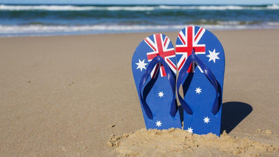 Australian flag sandals on a beach