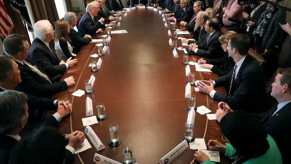 Donald Trump presides over a meeting of congressional legislators