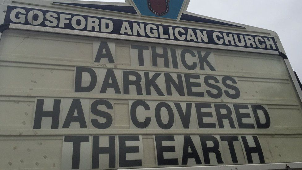 """Gosford Anglican Church billboard reads: """"A thick darkness has covered the earth"""""""