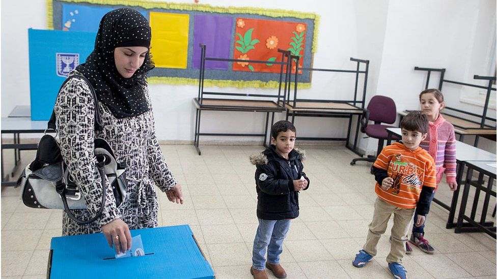 Israeli Arab woman casts her vote (2015)