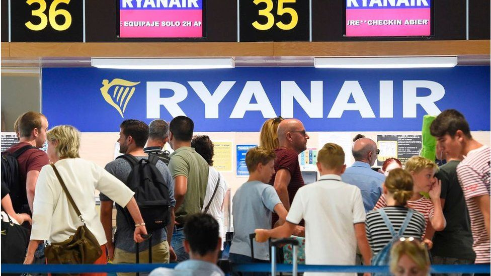 People queuing up to check in for a Ryanair flight