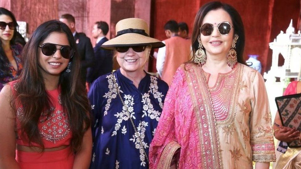 Former US Secretary of State Hillary Clinton poses with Isha Ambani (L) daughter of Mukesh Ambani, Chairman of Reliance Industries, and his wife Nita Ambani at Swadesh Bazaar, a curated showcase of traditional Indian crafts and art forms, in Udaipur, in the desert state of Rajasthan, India, December 9, 2018.