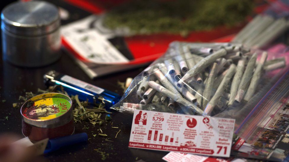 Free joints were passed out to protest a potential crackdown on legalised marijuana in Trump's America
