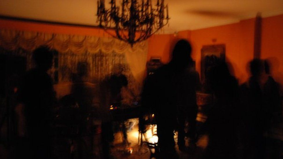 Blurry figures at a party in Iran in 2008/2009