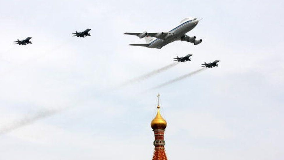 A Russian Il-80 plane and fighter jets fly over St Basil's Cathedral near Red Square in Moscow on 4 May, 2010 during a Victory Day parade rehearsal