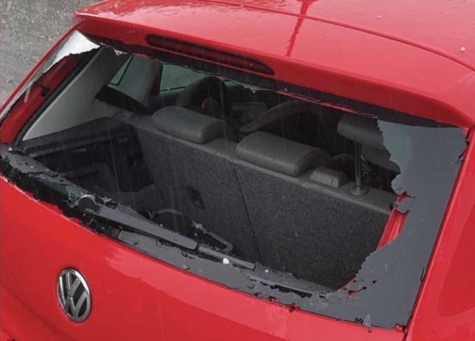 Kevin Messenger had his car window smashed in the hail storm
