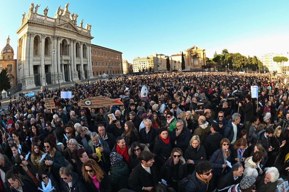 """People take part in the """"Sardine Movement"""" rally in Rome, 14 December"""