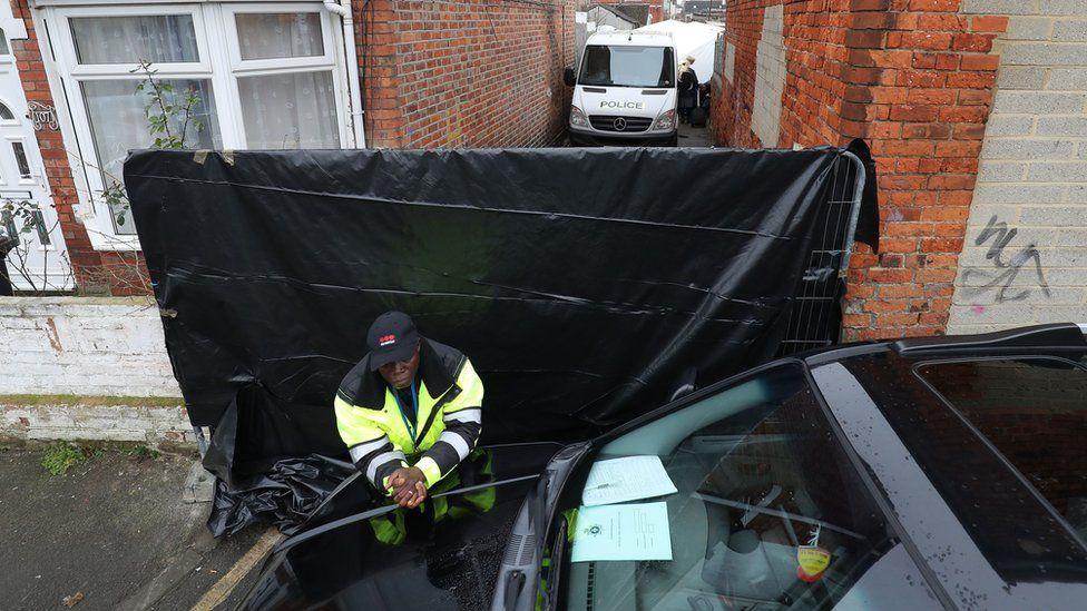 Black tarpaulin in alleyway