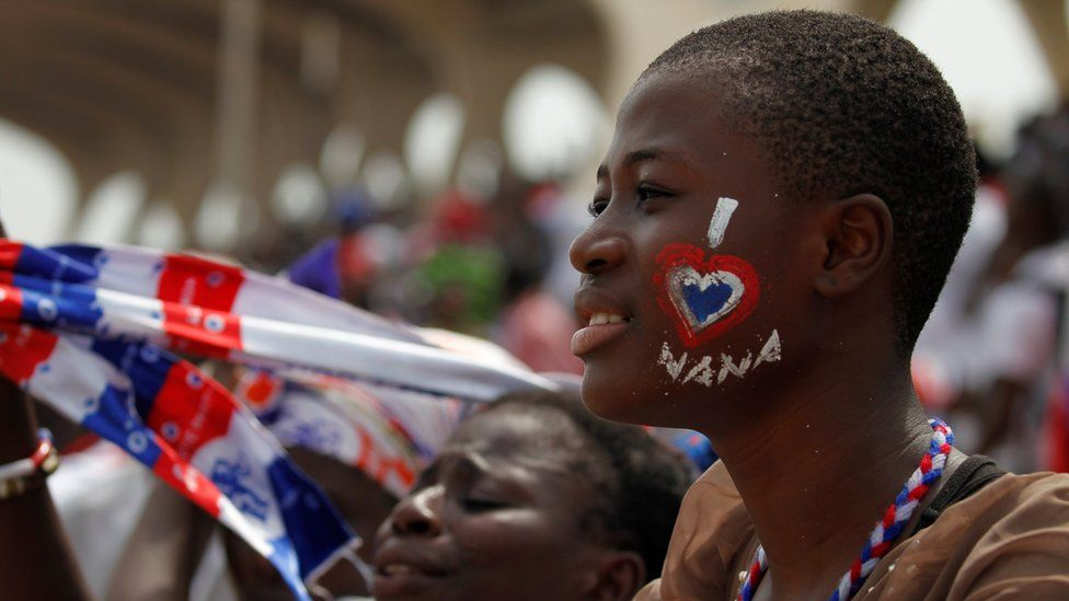 A supporter of Ghana's new president Nana Akufo-Addo with her face painted at his inauguration in Independence Square Accra, 7 January 2017