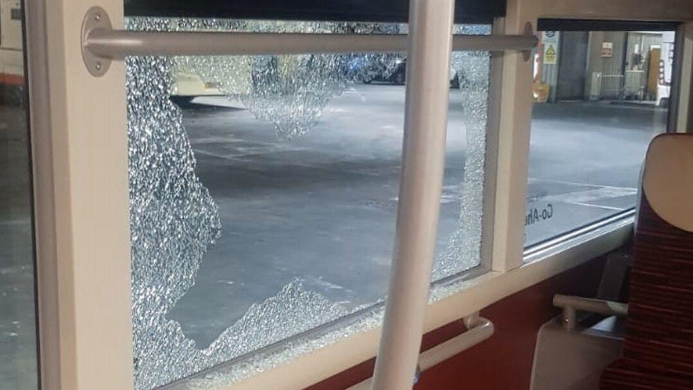 Smashed bus window