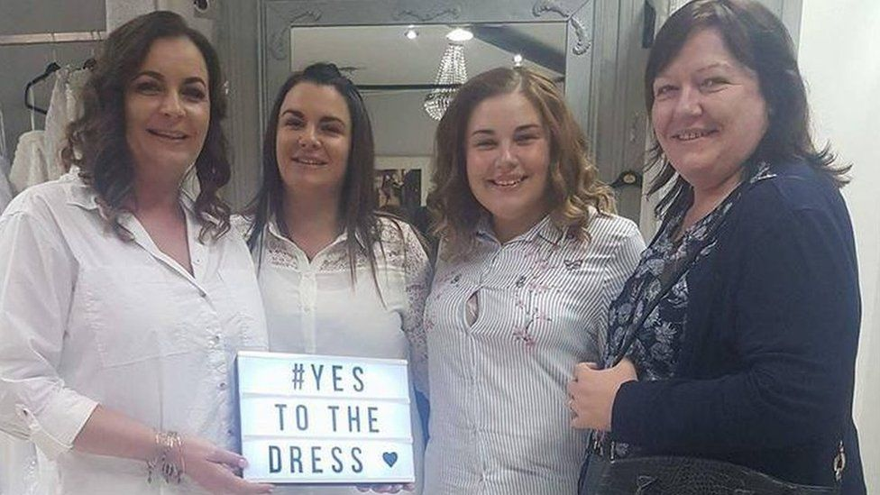 Laura Hussey and her family at a bridal store