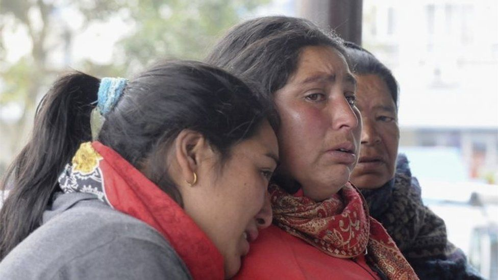 Relatives of a plane crash victim wait for information at Pokhara airport