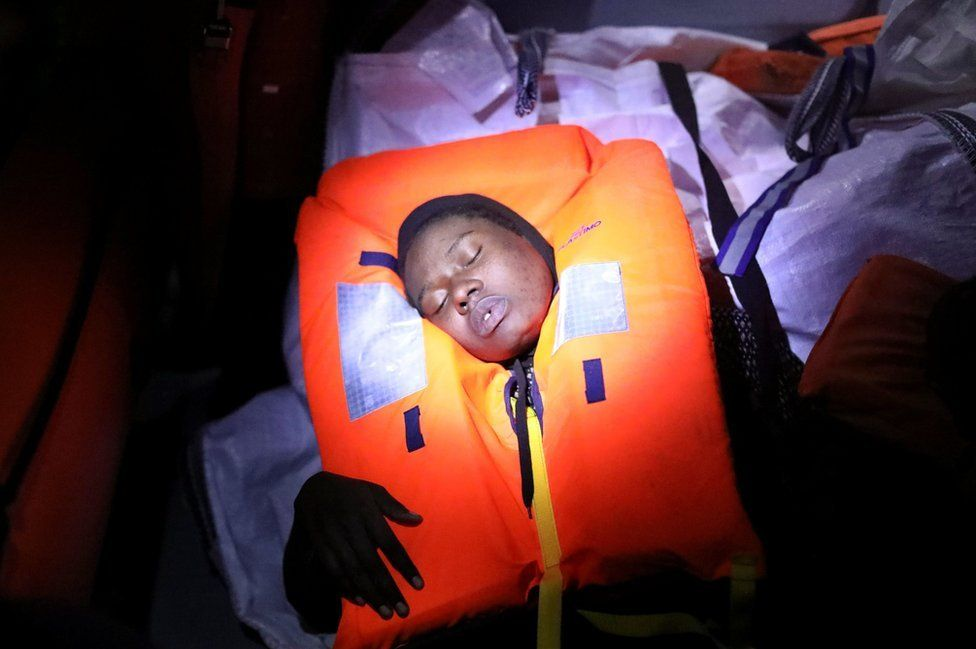 Mata, 23, who's from Nigeria, tries to recover after fainting during a rescue operation