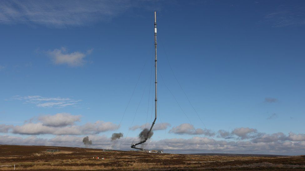 The Bilsdale TV and radio mast collapsing as part of the controlled demolition