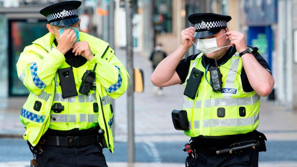 Police wearing face coverings