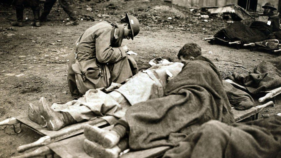 A chaplain writing letters home for wounded British troops during the British victory at Cambrai, France, 1917