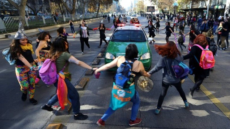 Demonstrators surround a police vehicle during a march demanding an end to sexism and gender violence in Santiago, Chile June 6, 2018