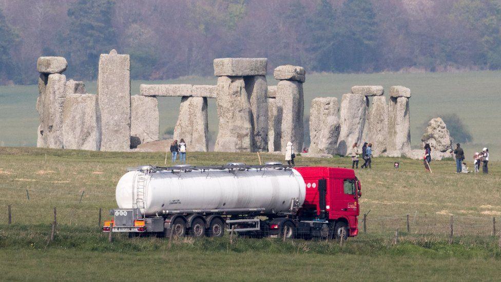 Lorry driving past Stonehenge.