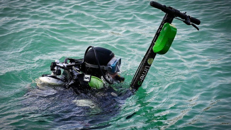 An e-scooter belonging to US firm Lime is fished out of the sea in Marseille