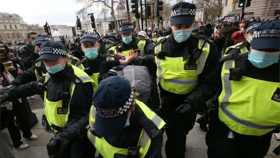 Police arrest a demonstrator at the Kill the Bill protest