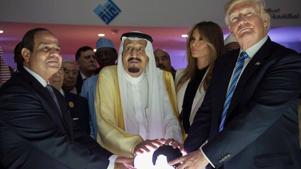 Egyptian President Abdul Fattah al-Sisi, Saudi Arabia's King Salman and US President Donald Trump place their hands on a globe at the World Center for Countering Extremist Thought in Riyadh, Saudi Arabia, 21 May 2017
