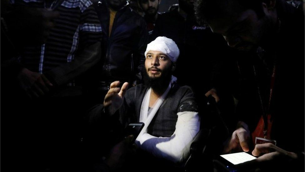 Hisham Siddiqui, a Jamia Millia Islamia university student, who was injured during a protest on Sunday, talks to media outside a hospital in New Delhi, India, December 16, 2019.
