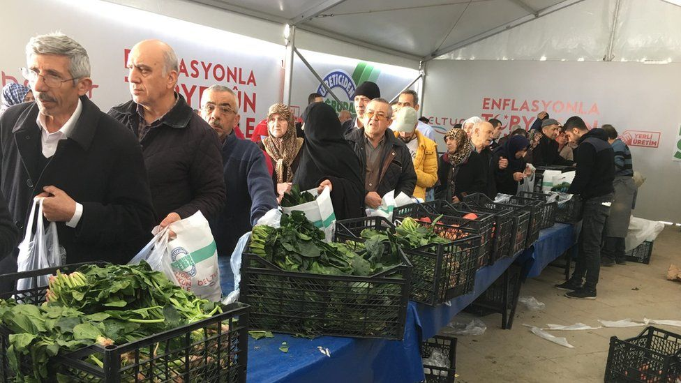 Istanbul residents queue along the vegetable stalls to buy produce