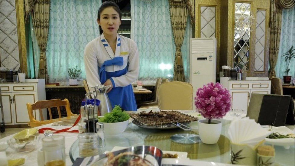 A picture made available on 03 June shows a North Korean waitress at a North Korean restaurant in Beijing city, China, 02 June 2016.