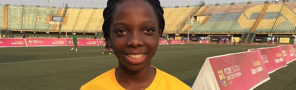 Imalashe Sulyman, the only girl recruit at the Barcelona Academy in Lagos, stands on the football pitch.