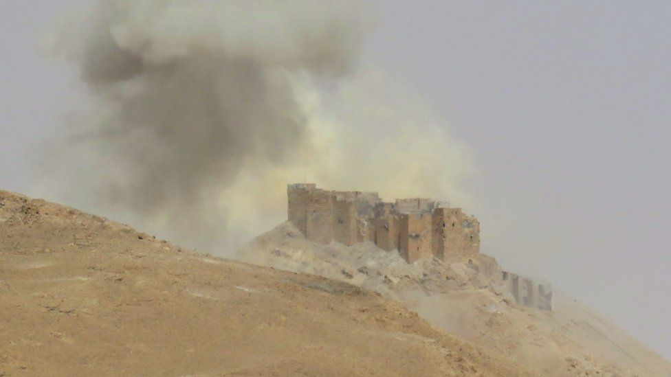 Smoke billows from the Palmyra citadel on March 25, 2016, during a military operation by Syrian troops to retake the ancient city from the jihadist Islamic State (IS) group.