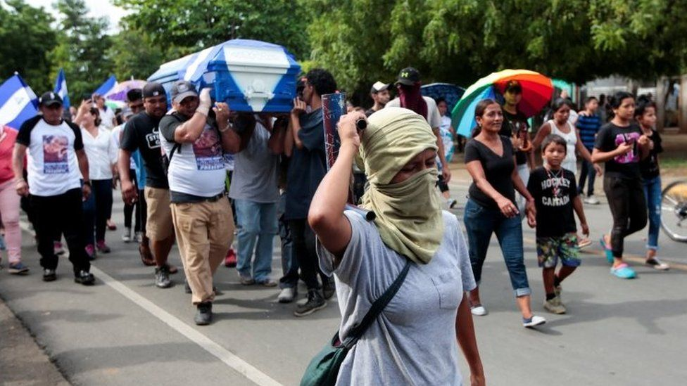 Demonstrators take part in funeral service of a man shot during recent protests in Nicaragua. Photo: 15 June 2018