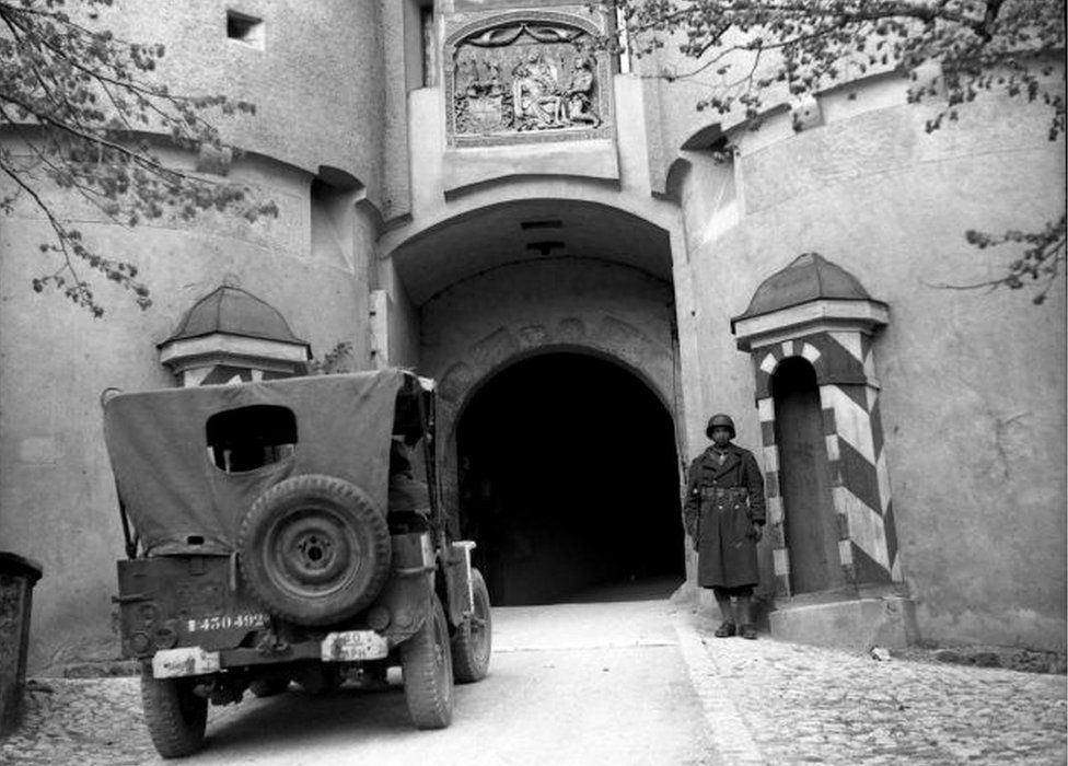A French soldier guards the entrance to the castle in Sigmaringen, 23 April 1945