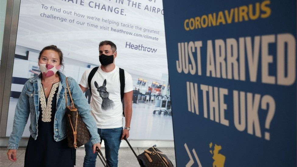 Passengers arrive at Heathrow Airport from Mykonos