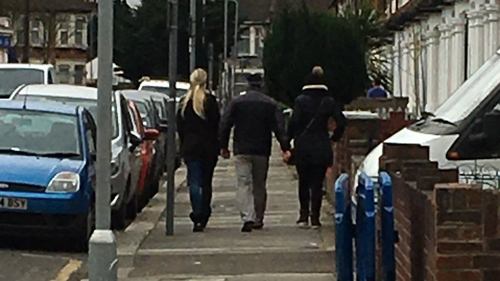 Two women and a man left the house, shouted at us, then walked away
