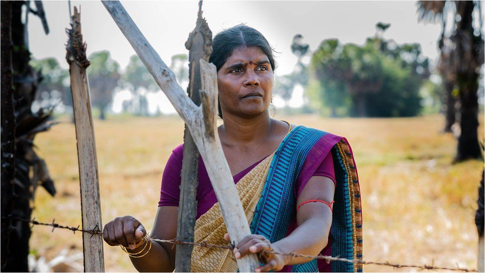 Jakakumari along a barbed fence wire at the field