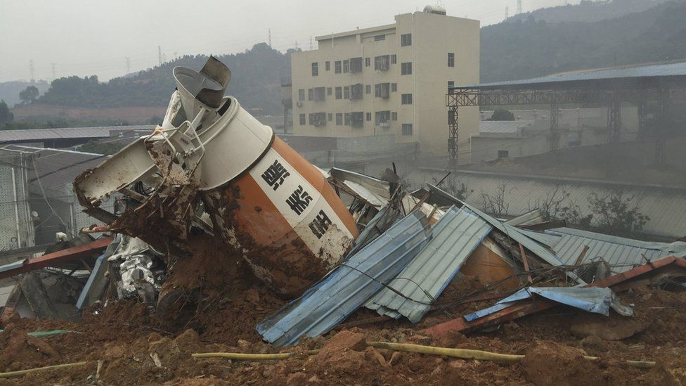 A damaged vehicle is seen among the debris at the site of a landslide at an industrial park in Shenzhen, Guangdong province, China, December 20, 2015.